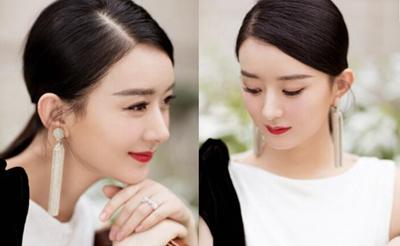 赵丽颖产后首次出席活动 一身白色长裙优雅端庄