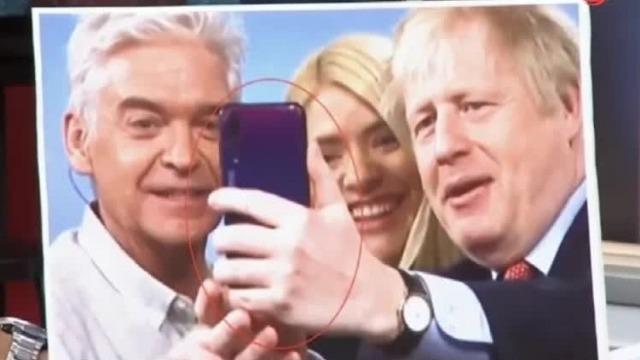 英国首相用华为拍照 绿营补刀