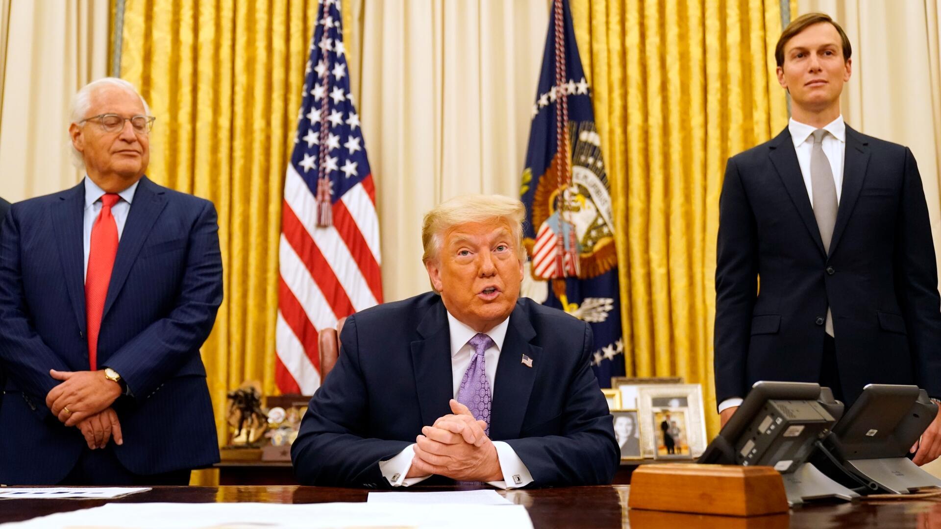 (特朗普8月13日在白宫椭圆形办公室。图源:《华盛顿邮报》)