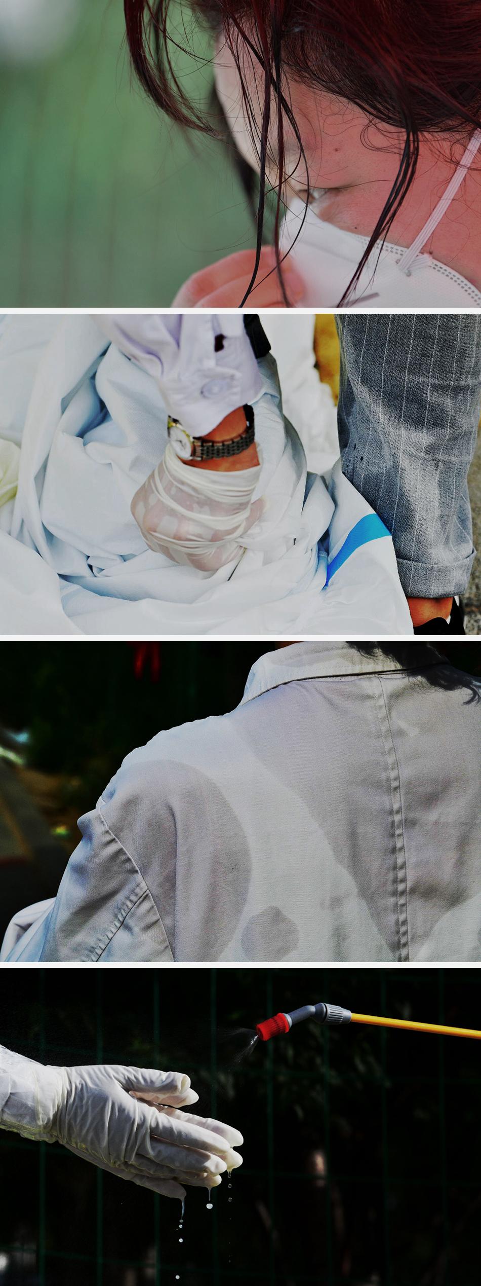 6月15日,北京丰台区一处咽拭子采集点,工作人员们在高温下工作。汗水打湿了他们的头发,脱下防护服后的衣服已经湿透。人民视觉 图