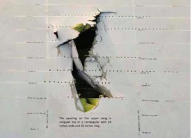 砸中机翼的金属块,断裂边长60cm,宽 25cm,中心点与圆边距离 26cm。