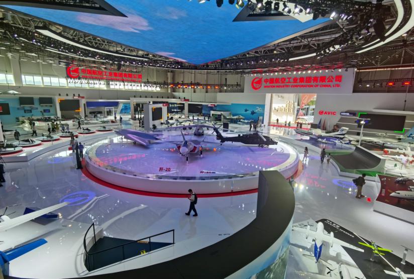 """在航空工业展厅, """"20时代""""三款国之重器歼20、运20、直20位于展厅正中央。"""