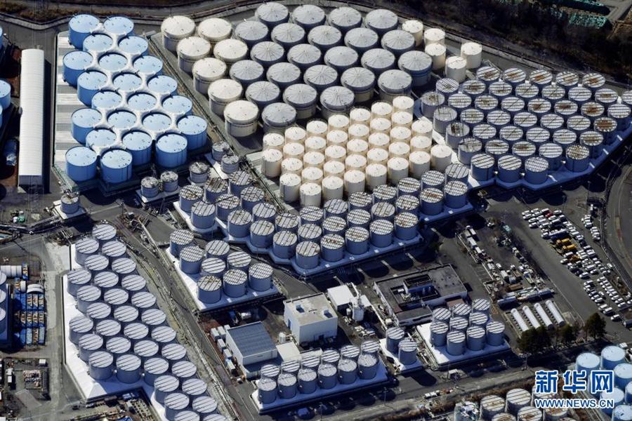 这是2021年2月13日拍摄的日本福岛第一核电站核污水储水罐。新华社/共同社
