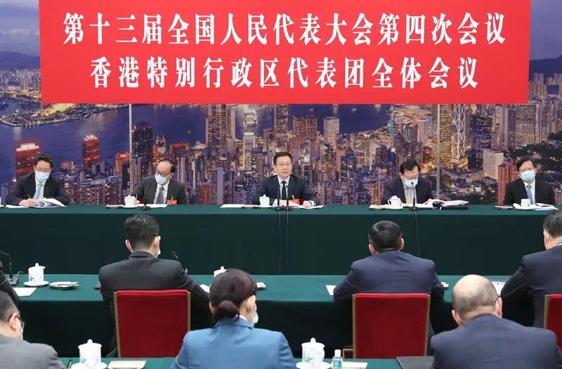 3月7日,中共中央政治局常委、国务院副总理韩正参加十三届全国人大四次会议香港代表团的审议。新华社记者 丁林 摄