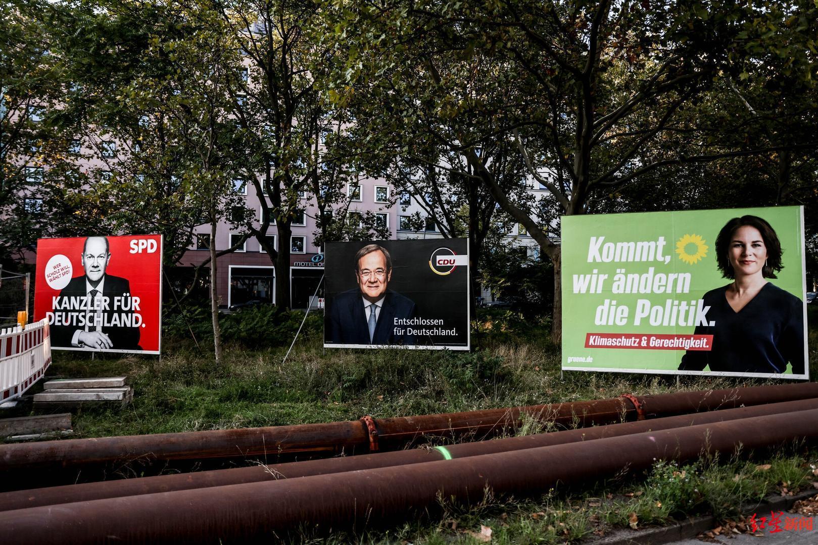 ▲三位德国总理候选人的竞选广告牌矗立在柏林