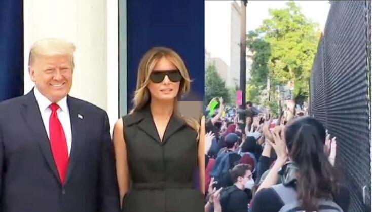 讽刺!特朗普和夫人开心合照 民众在白宫铁丝网外怒吼抗议