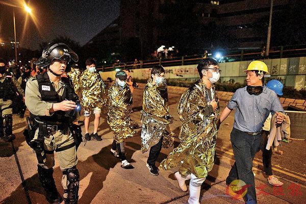 """香港213人被控暴動罪提堂 創""""修例風波""""以來單日最多"""