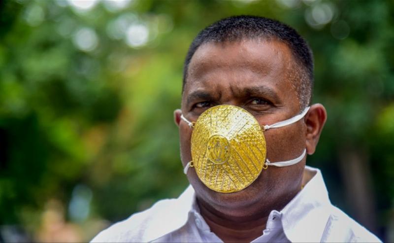 【雅虎排名】_造价2万8!印度男子戴金口罩炫富,有用?