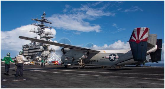 """8月13日,美国海军""""里根""""号航母在菲律宾海出动舰载机训练"""