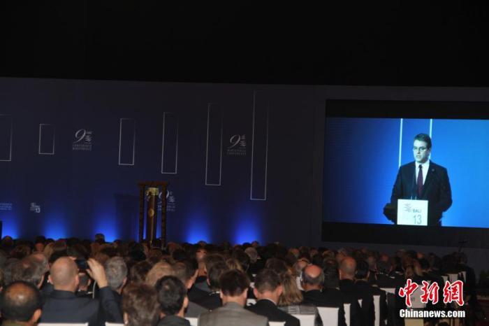 2013年12月3日,世贸组织第九届部长级会议在印尼巴厘岛隆重开幕。图为世贸组织总干事阿泽维多致辞。中新社发 顾时宏 摄