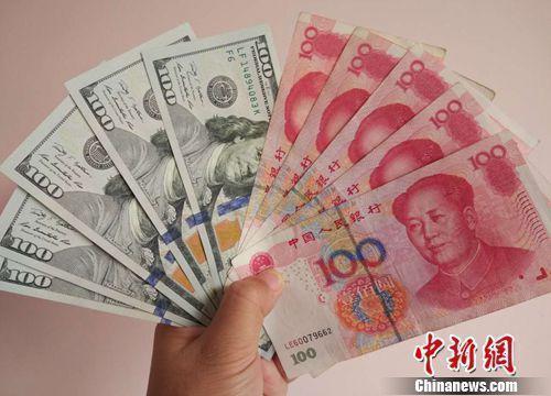 人民币和美元资料图。<a target='_blank' href='http://www.chinanews.com/' >中新网</a>记者 李金磊 摄
