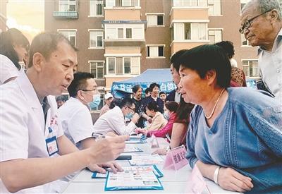 惠泽园社区的邻居节办的有声有色。王雁摄