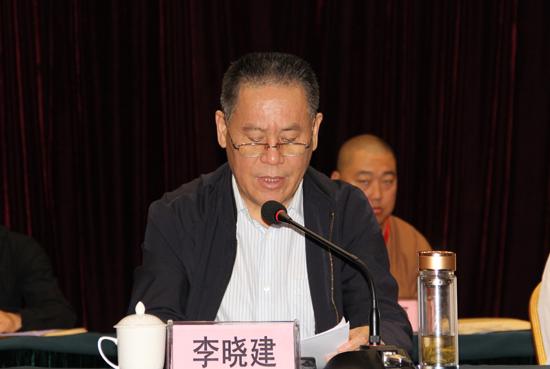 陕西省民宗委副主任李晓建发言(图片来源:陕西省佛教协会)