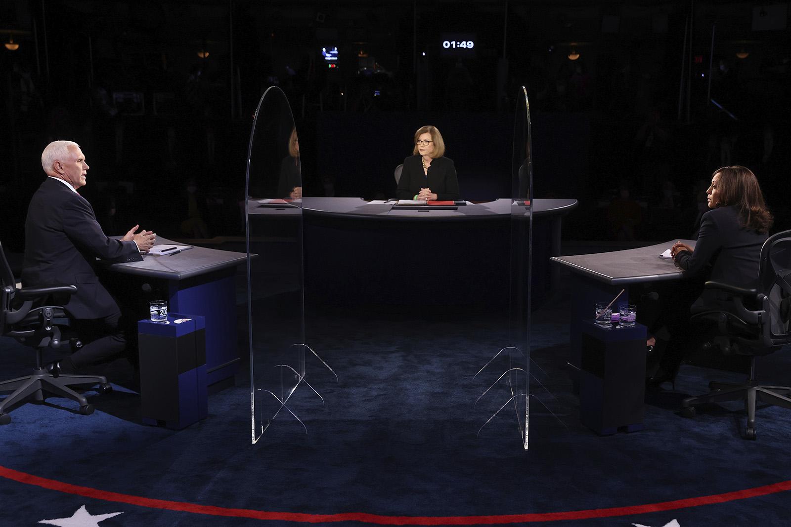【惠州精品】_现场!美副总统候选人隔3.6米辩论:不戴口罩,中间竖巨大玻璃板
