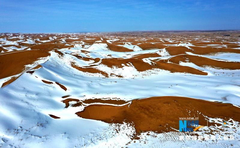 大漠雪霁美如画 甘肃民勤分外妖娆