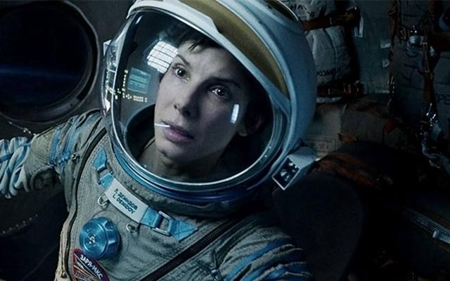 在科幻电影《地心引力》中,女主角因为中国空间站才得以重返地球。(图为剧照)