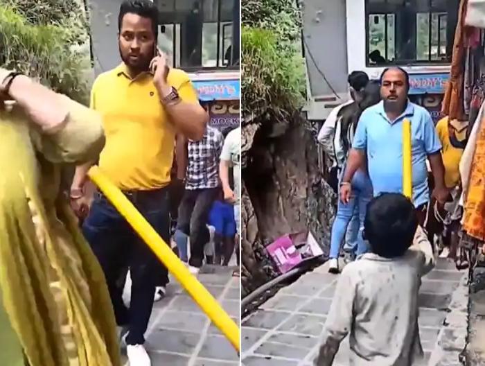 印度数十万人涌入景区 小男孩持棍提醒游客戴口罩