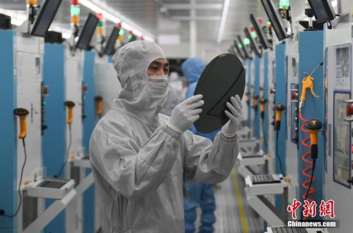 资料图:科技公司工作人员。<a target='_blank' href='http://www.chinanews.com/'>中新社</a>记者 王刚 摄